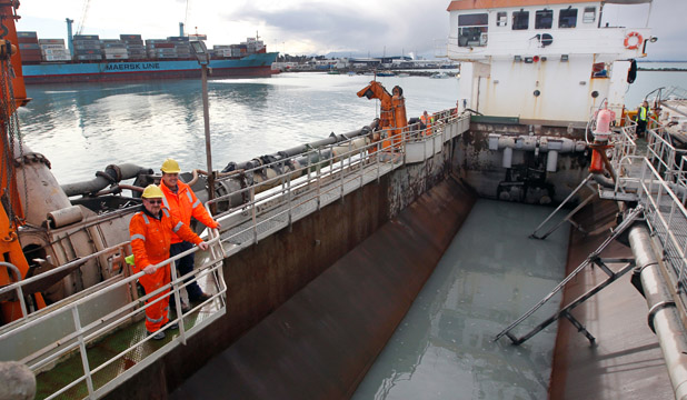 MUDDY WATERS: The Pelican is dredging at the Port of Timaru at present. Project manager Trevor Shields and Captain Kevin Martell, formerly of Timaru, on board.
