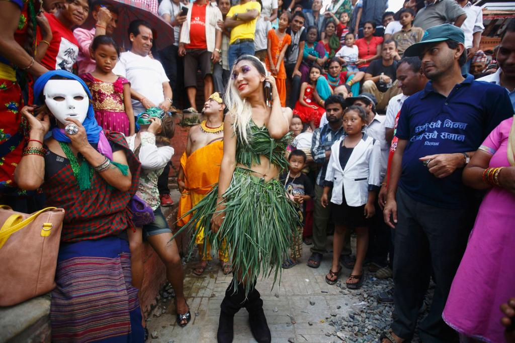 A reveller dances while taking part in a LGBT (lesbian, gay, bisexual, and transgender) pride parade to mark the Gaijatra Festival, also known as the festival of cows, in Kathmandu.