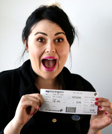 WONDER STRUCK: Tegan Frost with the ticket which put her on a flight hit by lightning.