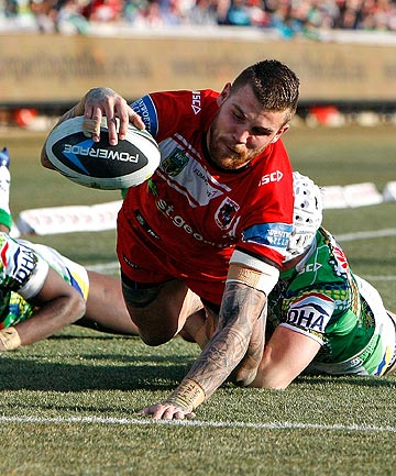 TRY TIME: Josh Dugan dives over to score for the St George Dragons in their comfortable win over the Canberra Raiders.