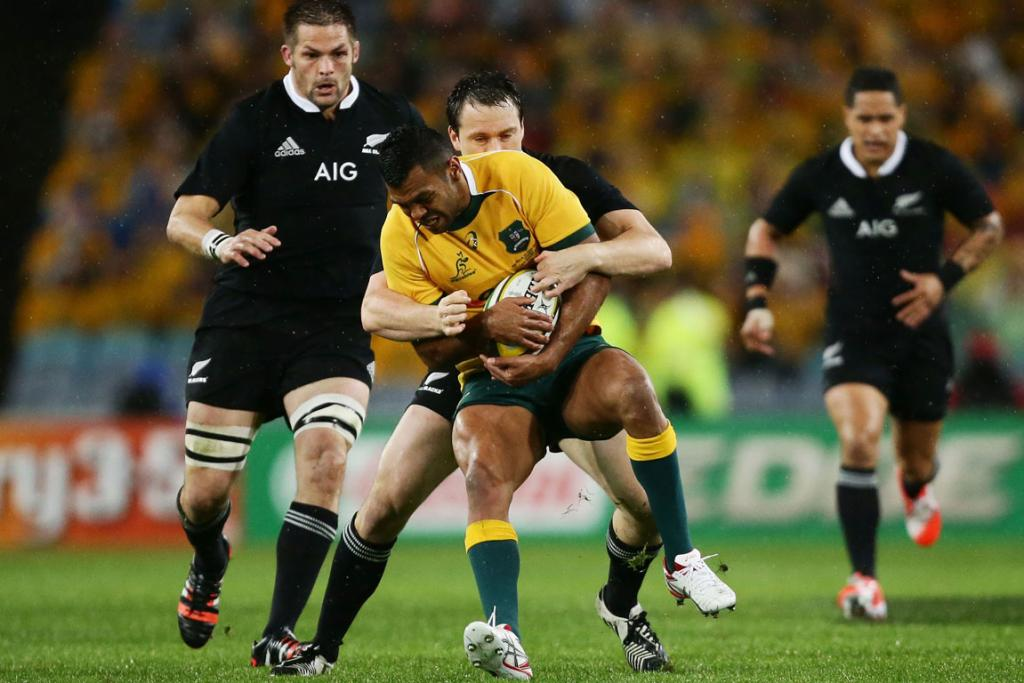 All Blacks fullback Ben Smith wraps up Wallabies first-five Kurtley Beale in the first half of the test.