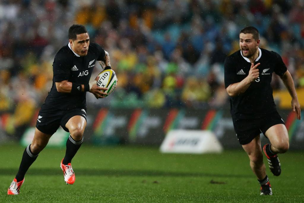 Aaron Smith makes a break early in the first half against the Wallabies while Dane Coles runs in support.
