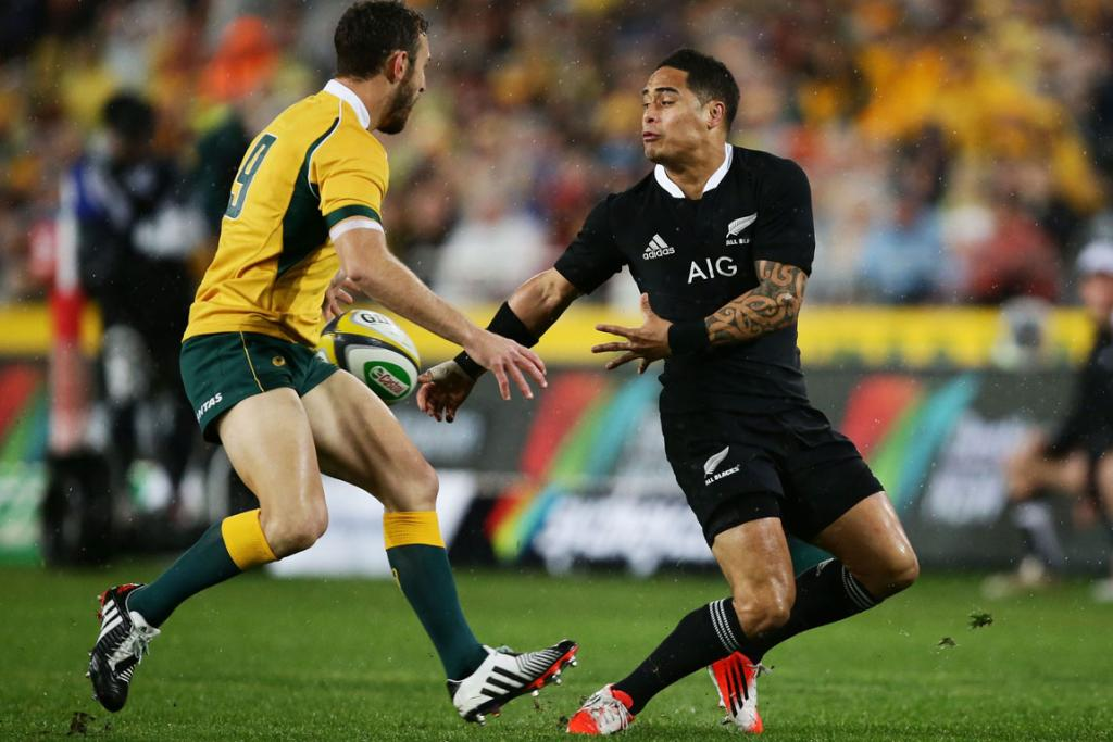 All Blacks halfback Aaron Smith pushes a pass to Dane Coles early in the first half of the Bledisloe Cup test in Sydney.