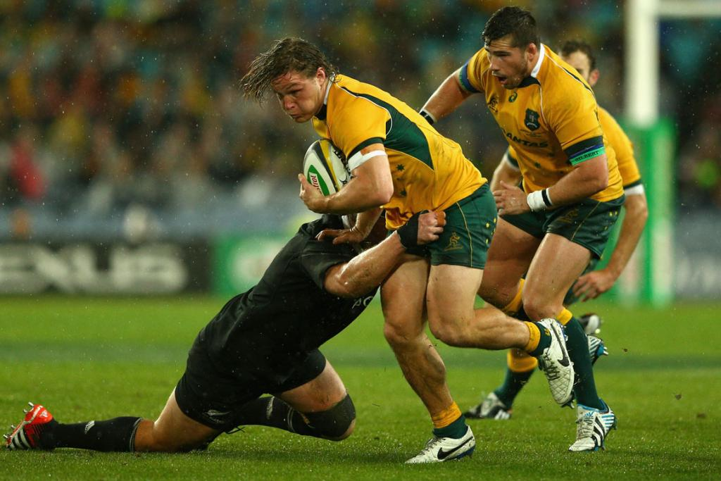 Wallabies skipper Michael Hooper attempts to break through the line in the first half of the test.