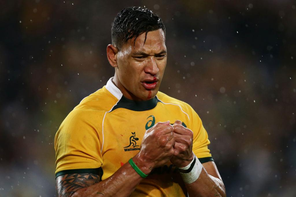 Wallabies fullback Israel Folau wipes the blood off his face after colliding with a team-mate during the first half in Sydney.