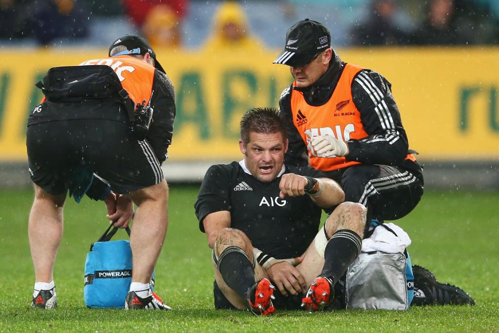 All Blacks skipper Richie McCaw is treated by the team's medical staff during the first half in Sydney.