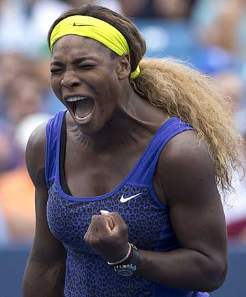 Serena Williams reacts during her win over Caroline Wozniacki at the Western and Southern Open tennis tournament in Cincinnati.