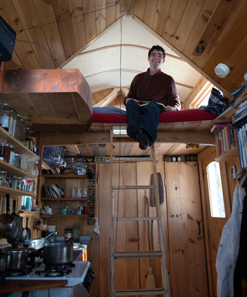 "Aldo Lavaggi said that thanks to his tiny house, he ""earns more than he spends,"" as a folk musician and can splurge on things like gourmet cheese from the local organic market. His home features a lofted bed, composting toilet, wood burning stove and full sink, and runs on a car battery and solar power."
