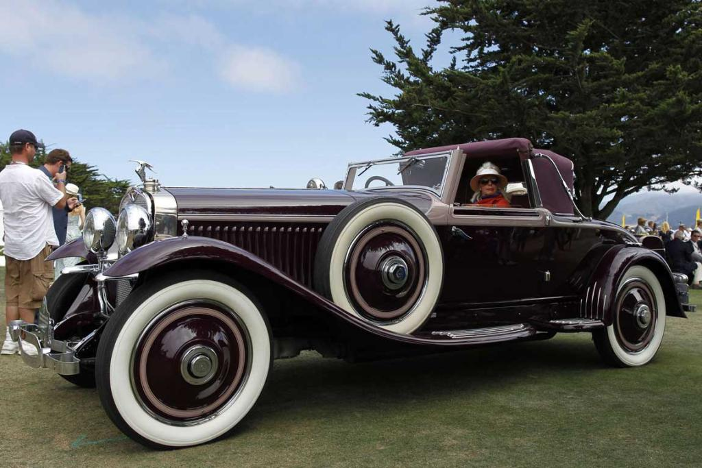 An entrant sits in her 1929 Hispano-Suiza H6B Hibbard & Darrin Cabriolet during the Concours d'Elegance in Pebble Beach, California. The Concours tops a week-long celebration of automobiles and car culture on the Monterey Peninsula.