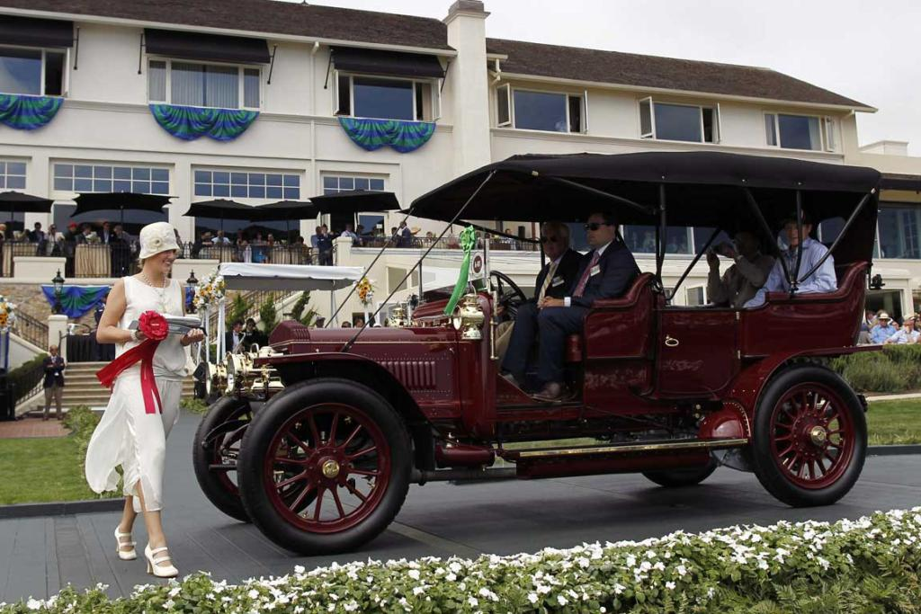 A 1908 Daimler TC48 Roi des Belges receives an award during the Concours d'Elegance at the Pebble Beach Golf Links in Pebble Beach, California. The Concours tops a week-long celebration of automobiles and car culture on the Monterey Peninsula.