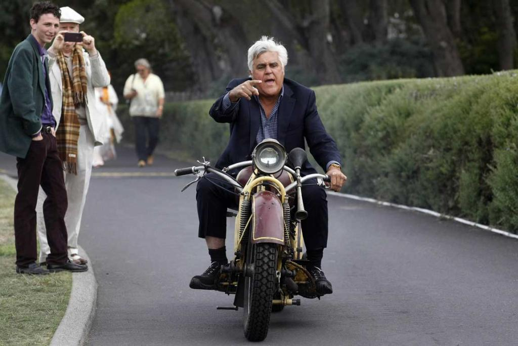 TV personality and car collector Jay Leno rides a 1930 Bohmerland motorcycle around the grounds during the Concours d'Elegance at the Pebble Beach Golf Links in Pebble Beach, California. The Concours tops a week-long celebration of automobiles and car culture on the Monterey Peninsula.