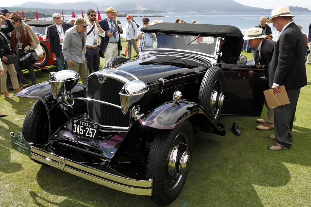 Judges inspect a 1930 Ruxton C Baker-Raulang Roadster during the Concours d'Elegance at the Pebble Beach Golf Links in Pebble Beach, California. The Concours tops a week-long celebration of automobiles and car culture on the Monterey Peninsula.