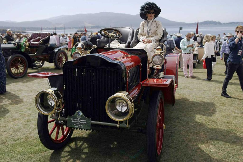 An entrant sits on a 1907 White Model G Runabout Prototype during the Concours d'Elegance at the Pebble Beach Golf Links in Pebble Beach, California. The Concours tops a week-long celebration of automobiles and car culture on the Monterey Peninsula.