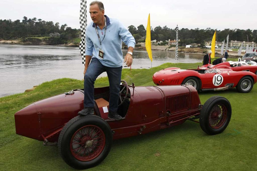 A 1928 Maserati Tipo 26 Monoposto is parked on the 18th fairway of the Pebble Beach Golf Links during the Concours d'Elegance in Pebble Beach, California. The Concours tops a week-long celebration of automobiles and car culture on the Monterey Peninsula.