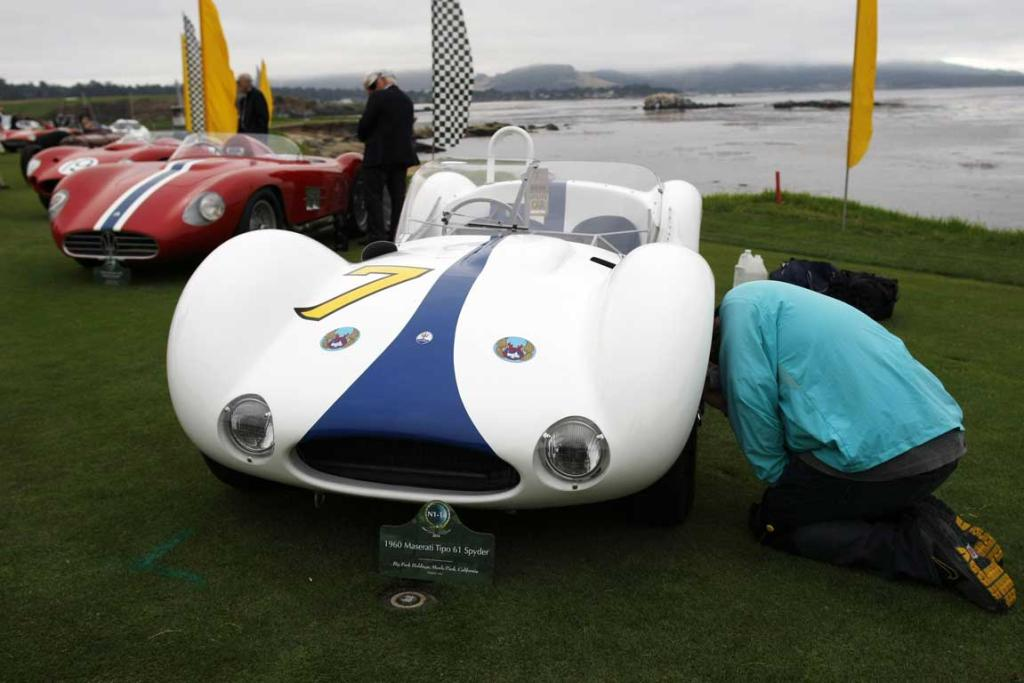 A 1960 Maserati Tipo 61 Spyder is prepared for the Concours d'Elegance on the 18th fairway of the Pebble Beach Golf Links in Pebble Beach, California. The Concours tops a week-long celebration of automobiles and car culture on the Monterey Peninsula.
