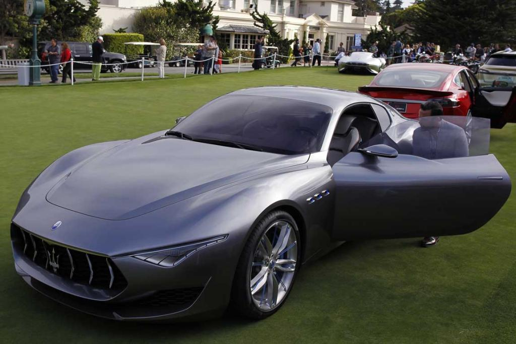 "A Maserati Alfieri concept car is displayed on the putting green at the Pebble Beach Golf Links in Pebble Beach, California. The ""concept lawn"" is part of the Concours d'Elegance."
