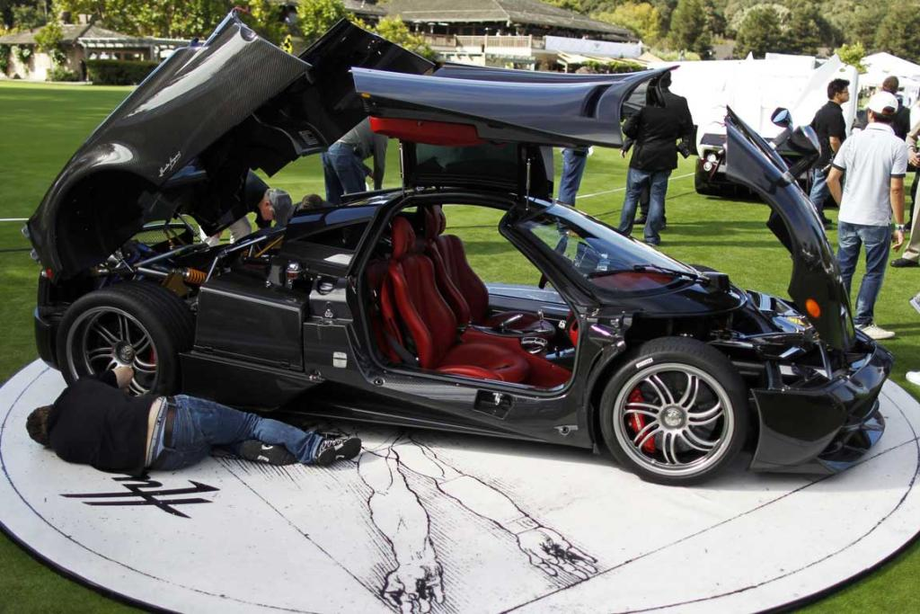Technicians put the finishing touches on a Pagani Huayra supercar during The Quail, A Motorsports Gathering car show in Carmel, California. The event is held during the Pebble Beach Automotive Week which culminates with the Concours d'Elegance.