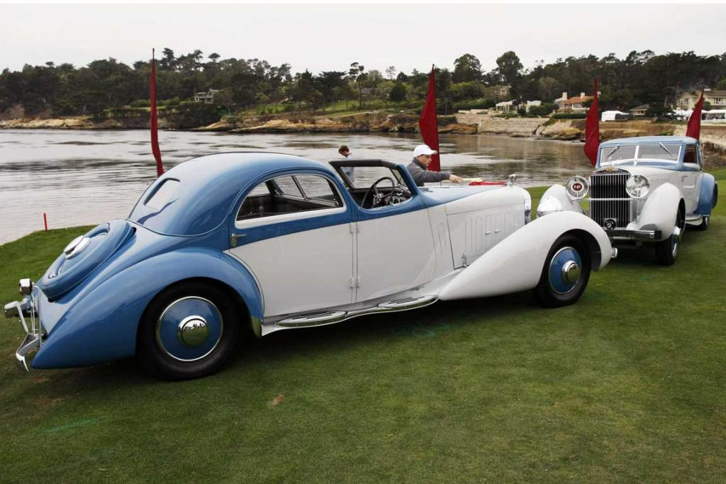 A 1934 Hispano-Suiza K6 Fernandez et Darrin Coupe Chauffeur (left) and a 1934 Hispano-Suiza J12 Fernandez et Darrin Coupe de Ville sits on the 18th fairway of the Pebble Beach Golf Links during the Concours d'Elegance in Pebble Beach, California. The Concours tops a week-long celebration of automobiles and car culture on the Monterey Peninsula.