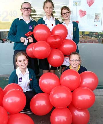 GIVING BACK: Marist College students Isabelle Burr, Abby Geddes, Elise Catley, Samara McKenzie and her sister Maxee McKenzie who attends Marist Primary are collecting donations for Heart Kids Awareness Month.