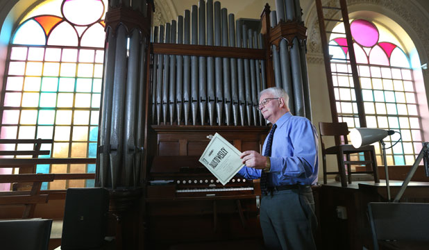 PRESTIGIOUS PIPES: St Mary's Basilica organist Raymond White with the parish's 99-year-old organ, which needs to be refurbished.