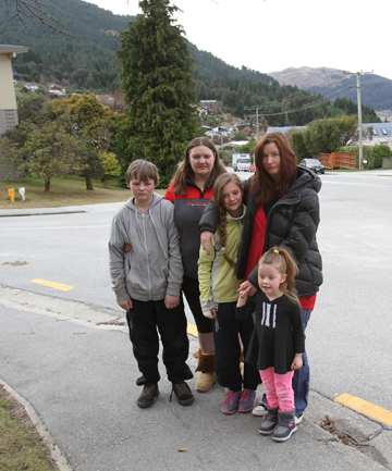 SCARED: Joshua Swain, 13, and mum Theresa with Marimba Powley and her daughters Niamh, 11, and Tara, 4, are afraid of what changes to Queenstown's school bus system could mean for their journey from Fernhill to town.