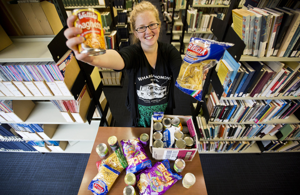 Fines paid: Massey University student Kelsey Pratt donated 37 food items and had her $170 library fine wiped.
