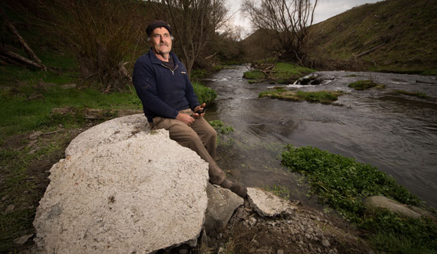 Hawke's Bay farmer, Ken Miller, sits on the half tonne concrete lid that trapped him by the arm.