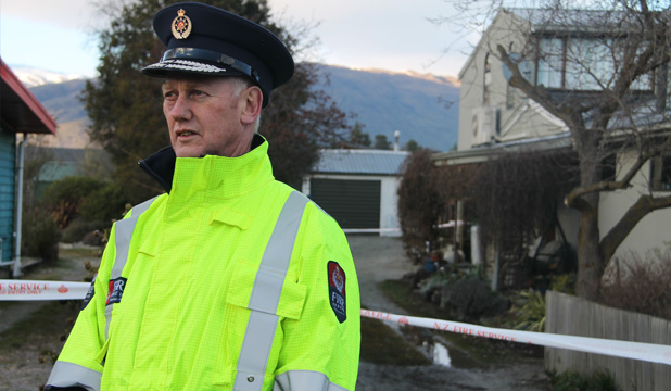 SCENE INVESTIGATION: Fire Service East Otago area commander Laurence Voight speaks to media outside the property of a fatal house fire in Wanaka early this morning. A man, sleeping in a granny flat at the back of the property, was killed in the blaze.