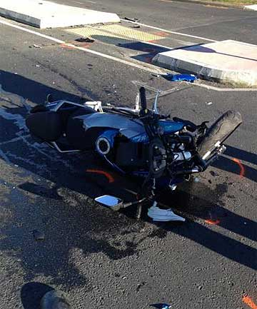 CRASH: The rider of the motorcycle was taken to hospital with facial and chest injuries.