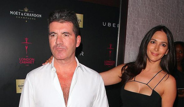 CHEST FACTOR: The perma-tanned, cleavage-loving Simon Cowell alongside his classy, chic partner Lauren Silverman.