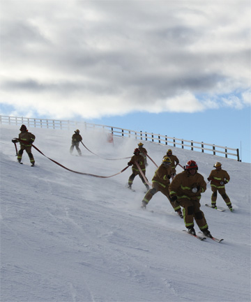 HEAVY HOSES: The Frankton and Wanaka firefighting teams were neck and neck throughout the Firefighter Chillfactor Challenge on Coronet Peak.