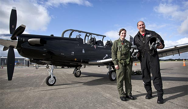 LIFTOFF: Pilot Officer Nicole Brooke and pilot Tom Webster with the new Beechcraft T-6C Texan II training aircraft.