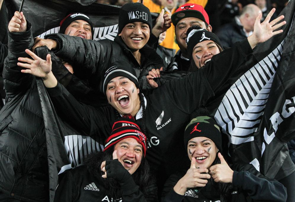 All Blacks supporters cheer at Eden Park.