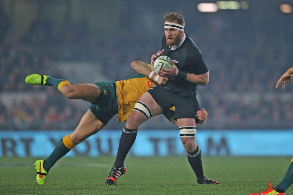 Kieran Read shows his incredible strength as a Wallabies player attempts to take him down in a diving tackle.