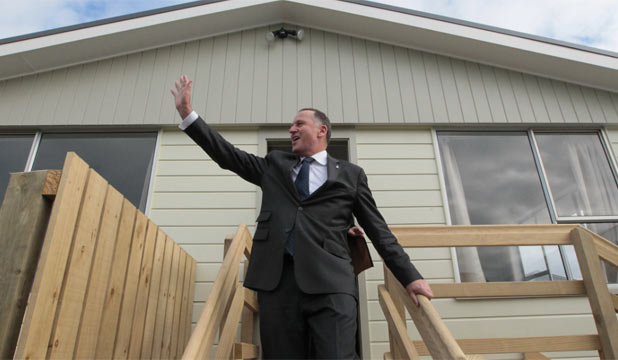 HOME, SWEET HOME: Prime Minister John Key visits the first homes refurbished by prisoners in the Christchurch suburb of Aranui on Saturday. Key will launch National's election campaign in Manukau on Sunday.