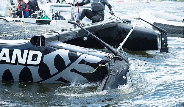 COLLISION: Team NZ's rudder shows the damage after they were tail-gated by regatta leaders Alinghi and SAP Extreme in Cardiff today.