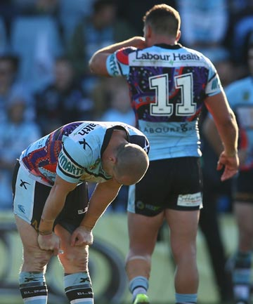 DEJECTED: Sharks players Jeff Robson, foreground, and Chris Heighington react with despair to their side's 22-12 home loss to Canberra.