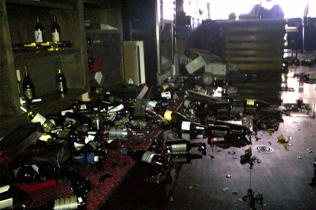 Wine bottles are scattered over the floor of Cult 24 Wine Bar in downtown Napa, California, following the quake.