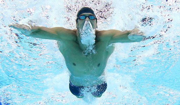 GREAT RETURNS: Michael Phelps powers to a gold medal in the medley relay at the Pan Pacific championships.