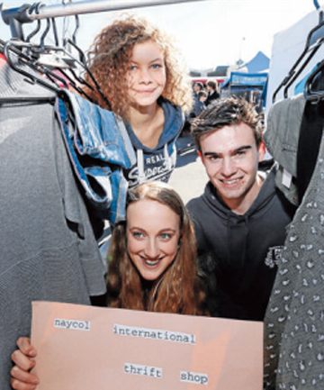 SECOND CHANCE: Nayland College students Laura Wieser, left, Laura Hedley and Jack Timbs with the Naycol Thrift Shop stall at the Nelson Market.