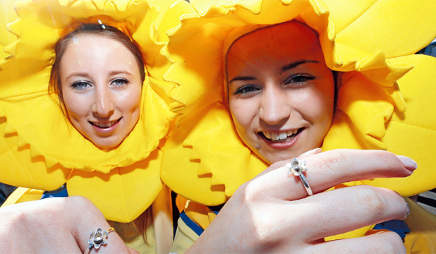 FLORAL TRIBUTE:  Kayleigh Inglis, left, and Ali Webb with the $79 silver  Daffodil Rings they are selling as part of their their business Vivacity, developed with Benjamin Black Goldsmiths.