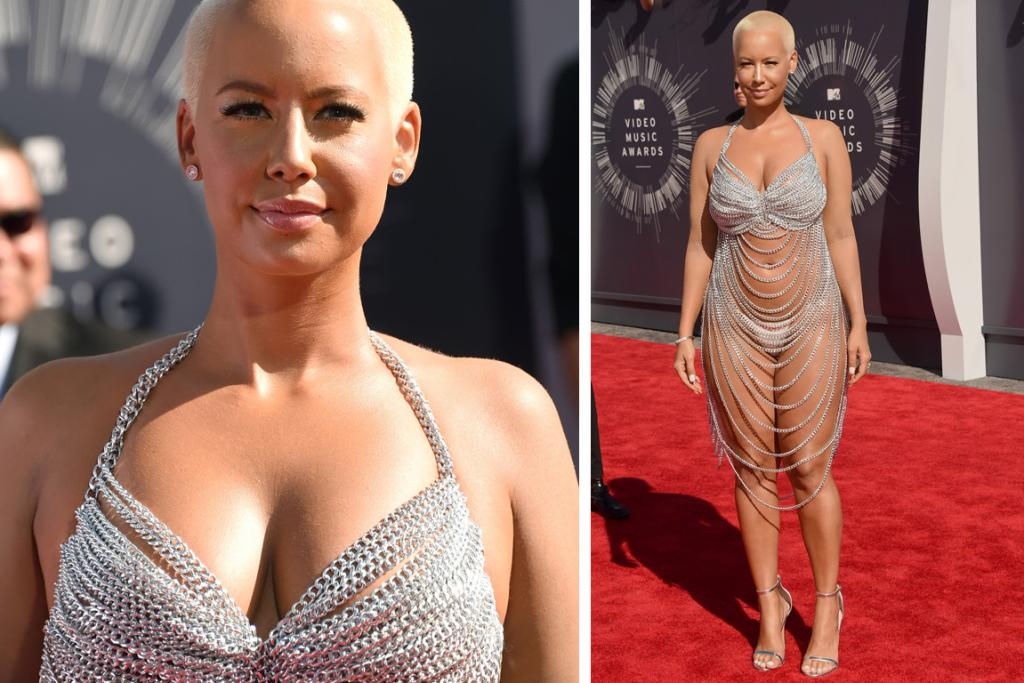 THE WOWZA: Hey, it's the VMAs, if there's any red carpet at which to wear a merkin and a few chains, this is it. Amber Rose's undoubtedly heavy Laura Dewitt 'dress' is certainly memorable, and will definitely get her a lot of attention. (We're imagining it's quite an eyeful from behind too).