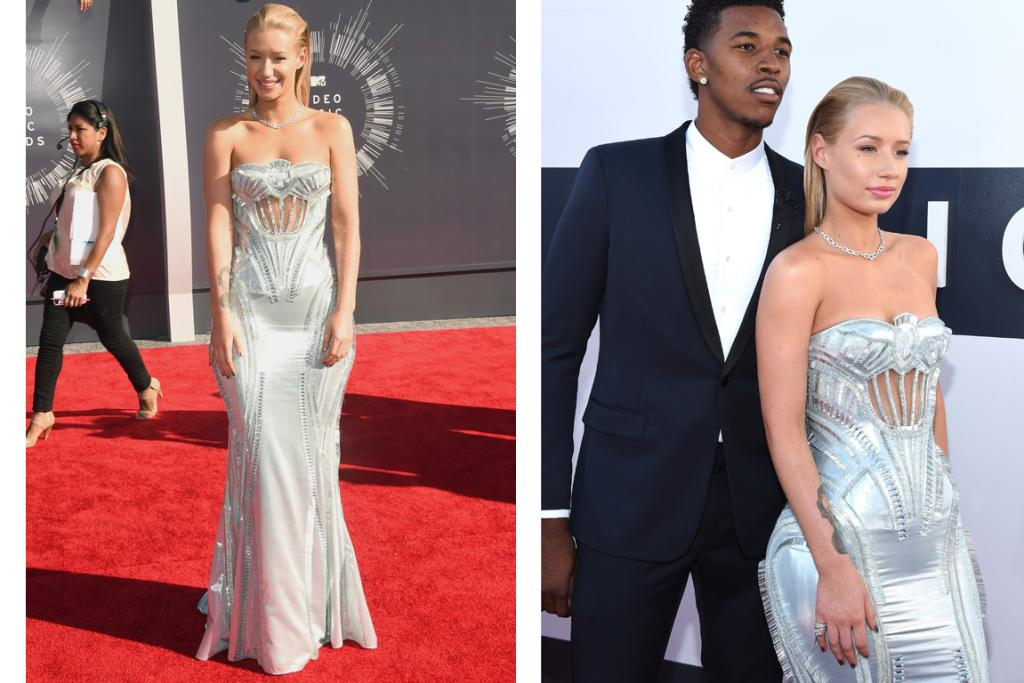 THE UNUSUAL BUT STILL GOOD: Here's Aussie rapper Iggy Azalea with her basketball player boyf' Nick Young. Now, Iggy looks stunning in this Versace dress, yes, but the more we stare at the dress' details the more we think it looks like a girly Transformer car pre-transformation ... or some kind of ice throwing Marvel superhero's shield. And yet she still manages to make it look good ... power to her ... that colour is amazing ...