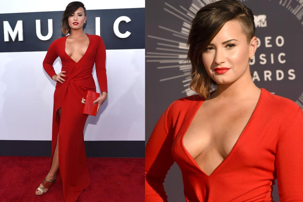 THE DRAMATIC: We don't often see Demi Lovato oozing glamour, and if she'd dialled down that extreme cleavage this Lanvin gown would definitely make our top five of the day. The colour is incredible on her, that waist-cinching knot is pure genius and her assymetric 'do offsets the whole look perfectly. A simpler shoe and a few more stitches in the chest area and she'd be bang on the money.
