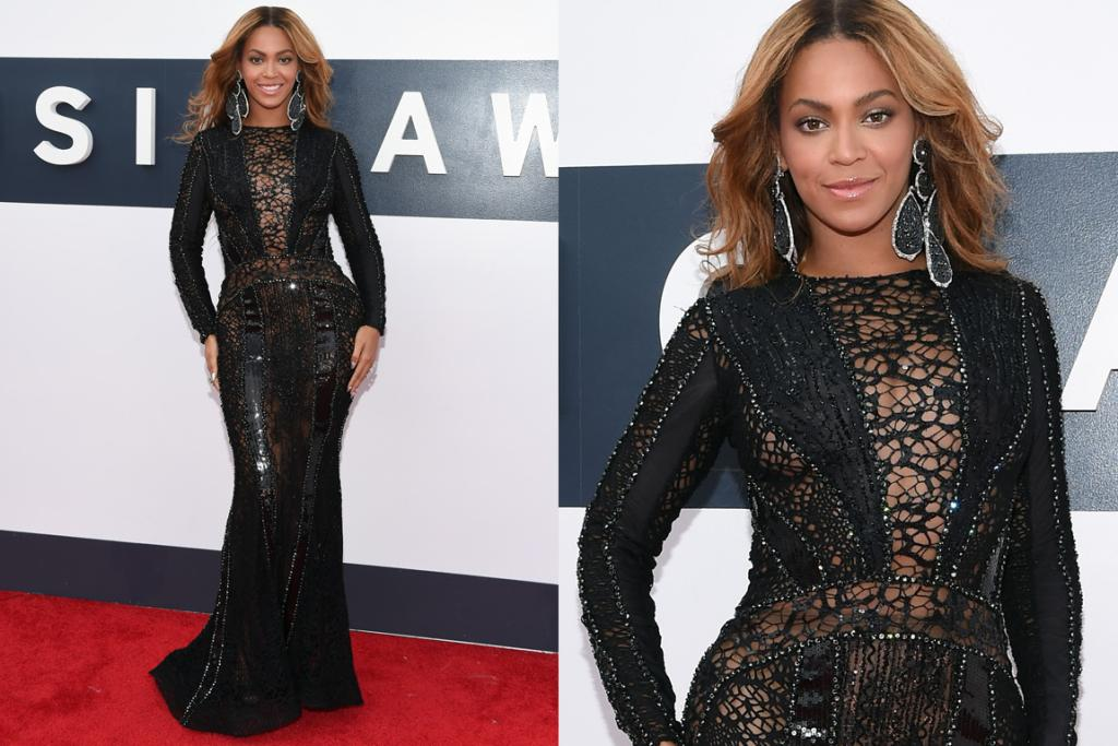 THE GREAT: It's not the most exciting, and it's far from unexpected, but nevertheless Queen B looks flawless in this full length figure-hugging gown. The combination of beading and lace give the dress a gorgeous sheen, and we love that she kept her hair and makeup natural.