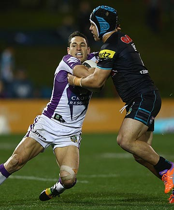 CLOSE QUARTERS: Melbourne fullback Billy Slater is tackled by Jamie Soward of the Panthers during the Storm's comfortable win tonight.