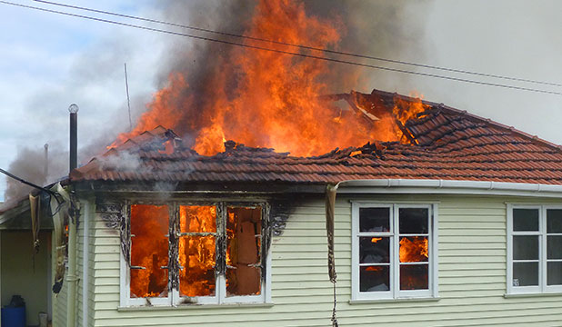 DESTROYED: Fire crews were called to the Housing New Zealand home in Collins Cres about 10.30am.