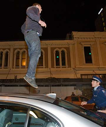 JUMPER: Luka Emerson De Spa in Christchurch in 2010 jumping on the roof of the car used by John Key.