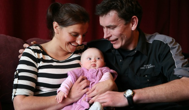 Invercargill parents Jackie Evans and Jason Holden with 7-month-old daughter Imogen