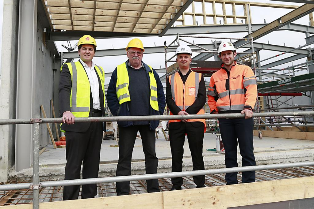 United front: From left, Ben Bridge, director Mainland Capital, Pete Dawson, president Christchurch Memorial RSA, Simon Brown, Warren and Mahoney principal architect, and Tim Glen, site manager for Fletchers, survey the view from the new RSA building.